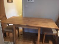 Extendable wooden dining table and 2 matching chairs for sale