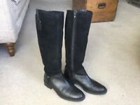 Black leather, knee length boots, worn once, made by Jones