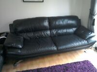 3 & 2 seater black leather sofas complete with matching footstool