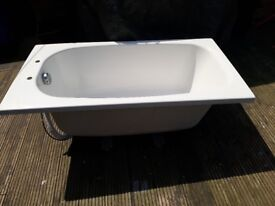 Bath - small measures 1300 by 700 white acrylic as new