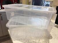 2 clear plastic shoe boxes