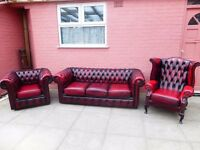 An oxblood red leather chesterfield suite