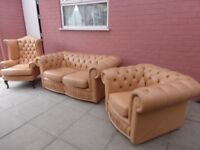 A Magnolia/Cream Leather Chesterfield Three Piece Suite