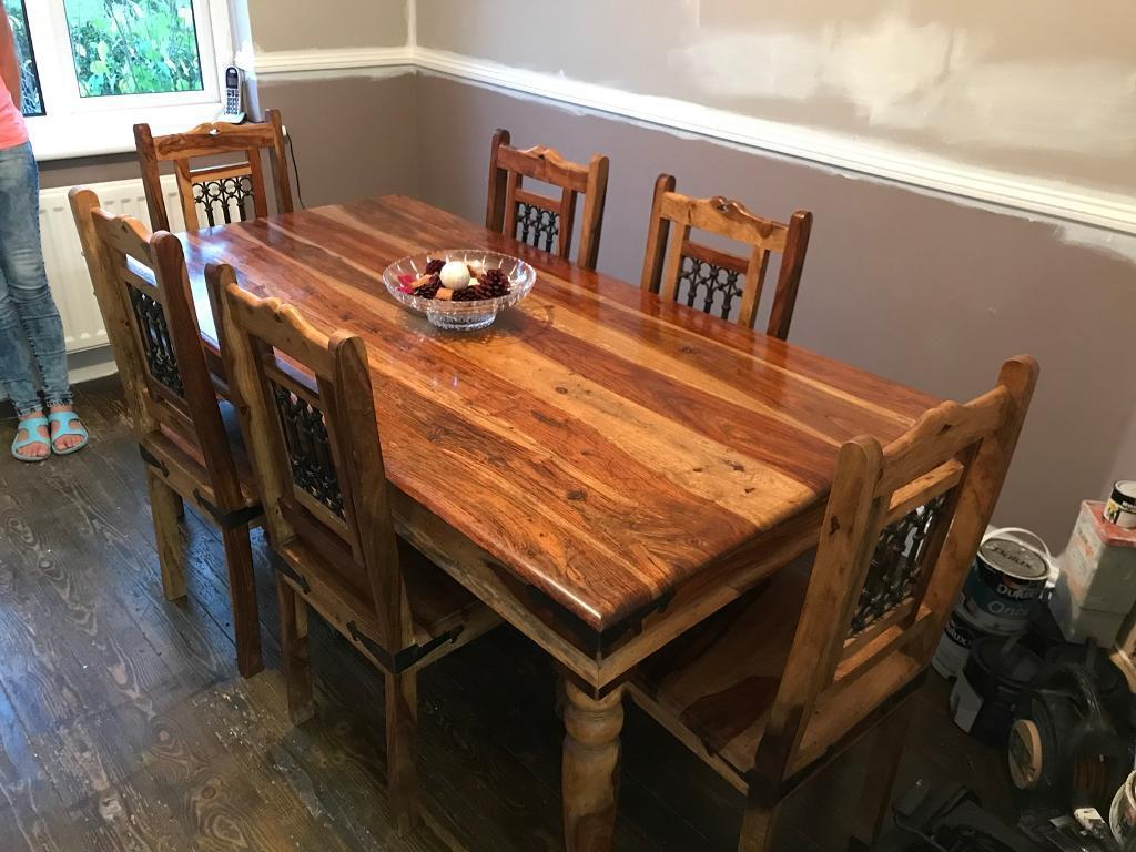 Solid heavy wood dining table with 6 chairs