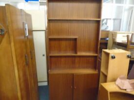 large solid wood shelf unit with cupboard space.