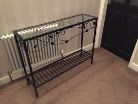 Glass console table, narrow with black metal motifs