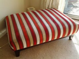 Multi-striped foot stool.