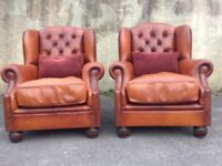 A Pair of Dfs Oskar Tan / Brown leather Chesterfield Armchairs in Great condition