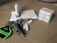 Nintendo wii console with wii fit board and 12 games