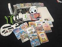 Wii console with a collection of games and accessories