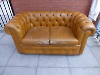 A Tanny/Gold Leather Chesterfield Two Seater Settee