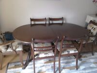 oval dining table and 6 chairs in good condition, table 1m 67cm x 91cm extending to 2m13cm