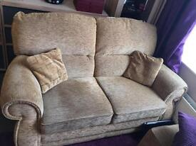 2 oatmeal two seat sofas and storage footstool