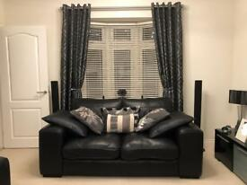 DFS black leather suite