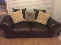Brown leather sofa .. not standard size... large