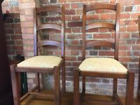2x darkwood chairs with cream seat