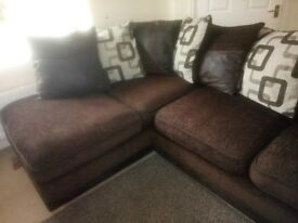 brown Corner couch and large swivel cuddle chair