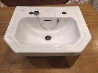 White ceramic cloakroom sink