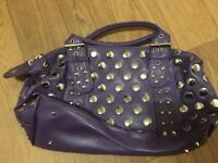 Small purple studded handbag