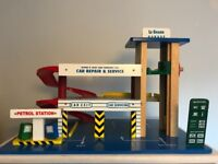 A gorgeous 'le toy van' retro style wooden garage. Would make a lovely Christmas present.