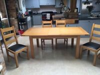 Dining table and chairs, excellent condition, double extensions.