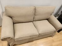 IKEA two seater sofa with cream piping