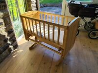Beautiful never used swinging bedside cot.