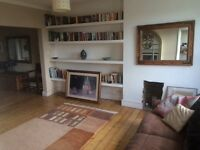 Attractive double room in fabulous three bed flat near West Hampstead .