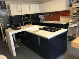 Schuller German Handless kitchen in blue gloss and white Glass gloss