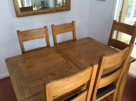 Extendable Oak dining table and 6 matching chairs