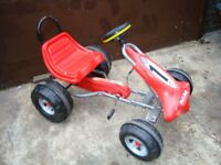 Childs go kart in red.