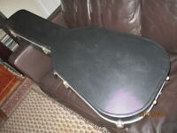 black moulded fibre hard guitar case. In good condition.