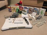 Nintendo Wii, 9 games, Wii Fit board, 1 controller and 2 nunchucks