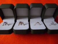 Four 9ct gold + diamonds new boxed rings, all 4 for £135. sizes L, M, O, Collect Swindon