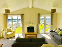Luxury Lodge for sale with 2017 & 2018 site fees included with decking! Call James!