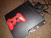 Sony PS3 with GTAV & a red pad.