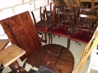 Extending mahogany dining table with 12 chairs