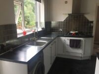 Kitchen white gloss and stainless steel handles with integrated dishwasher and fridge freezer etc
