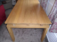 Oak Dining/Kitchen Table in new condition from a smoke free home.