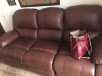 Brown leather sofa hardly used