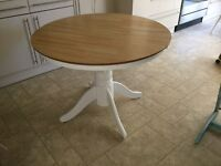 Solid wood extendable white round/oval dining table