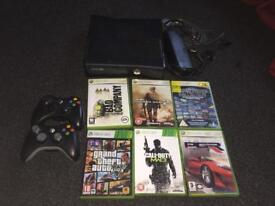 Xbox 360 slim with 6 games