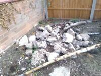 Assorted concrete rubble, also up to a ton of topsoil. Free on collection