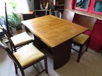 A vintage 40' table and dining chairs. Solid wood.