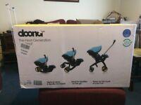 Doona car seat/stroller brand new in box. Red