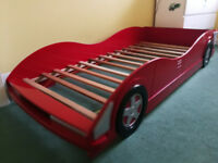 Red racing car shaped single bed in good condition perfect for boys.