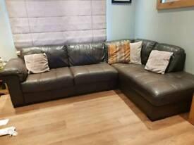 Brown corner sofa with storage pouffe