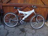 SHOCKWAVE FULL SUSPENSION MOUNTAIN BIKE IN GOOD CONDITION LACK OF USE REASON FOR SALE ONLY £30