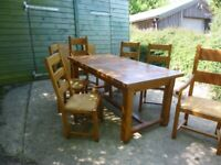 Extendable oak dining table & chairs