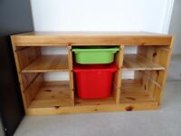Ikea wooden storage unit with boxes and shelves